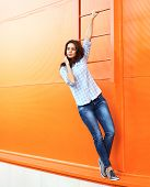 Summer, Fashion And People Concept - Pretty Young Girl In Casual Clothes Posing Outdoors Against Col
