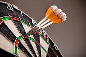 Three Darts Hitting Perfect 180 Score On Dart Board