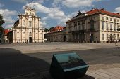 WARSAW, POLAND - JULY 31, 2013: Rococo church of the Visitandines (1780) at Krakowskie Przedmiescie Street in Warsaw, Poland. Painting by Bernardo Bellotto (Canaletto) is installed in the foreground.