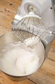 picture of food preparation tools equipment  - Freashly beaten stiff egg white inside a food processor - JPG