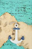Decor of seashells, starfish and old paper on  color wooden background