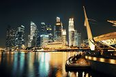 foto of singapore night  - Singapore skyline at night with urban buildings - JPG