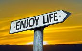 Enjoy Life sign with a sunset background