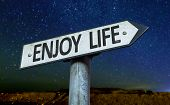 Enjoy Life sign with a beautiful night background