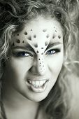 stock photo of panthera uncia  - Beauty woman with makeup in snow leopard style - JPG
