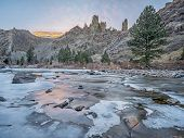 winter dusk over canyon of Cache la Poudre River above Little Narrows west of Fort Collins in northern Colorado
