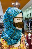 stock photo of arabic woman  - Traditional arabic women face mask and headscarf