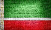 Flag of Chechen Republic on burlap fabric