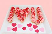picture of trays  - A tray of strawberry cupcakes presented as the letter I a heart shape and the letter U to say I Love You - JPG