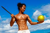 Happy Handsome Man Of Asian Appearance With Coconut On The Tropical Beach On Sunny Summer Day