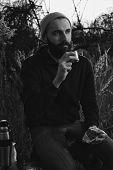 bearded lumberjack with sandwich and tea