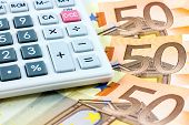 Fifty Euro Bills And A Calculator