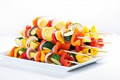vegetable kabobs on a plate