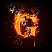 stock photo of g-spot  - Fire Swirl Letter G Isolated on Black Background - JPG