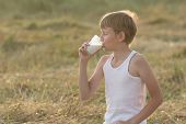 Teenage Boy With Closed Eyes Drinking Milk