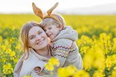 foto of bunny costume  - Little toddler child and his mother in Easter bunny ears having fun celebrating traditional Easter holiday - JPG