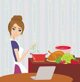 Housewife Looking In Laptop During Cooking Soup At Home Kitchen