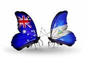 Two Butterflies With Flags On Wings As Symbol Of Relations Australia And Nicaragua