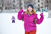 Girl Showing Thumbs Up Winter