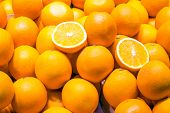 image of clementine-orange  - Background of some ripe oranges for sale at a market - JPG