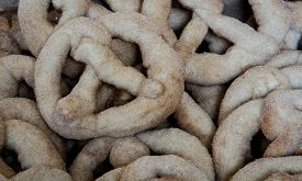 stock photo of doughy  - Assortment of homemade salty doughy pretzels at a market - JPG