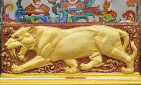 stock photo of bans  - There is the golden sculpture of ancient tiger beside the elephant dome Wat Ban - JPG