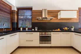 pic of mansion  - Horizontal view of modern furniture in luxury kitchen - JPG