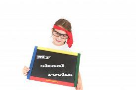 foto of cheeky  - a cheeky school girl holding a chalkboard - JPG