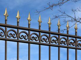 foto of stiletto  - Decorative metal fence with ornaments in old stiletto - JPG