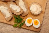 stock photo of butter-lettuce  - bread and butter egg greens and mayonnaise on a wooden board - JPG