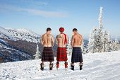image of peeing  - Three men peeing on the top of the mountain - JPG