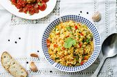 stock photo of saffron  - saffron rice with vegetables and cilantro on a white background - JPG