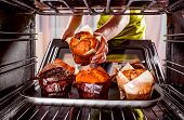 stock photo of oven  - Baking muffins in the oven - JPG