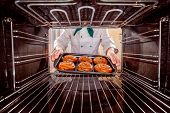 foto of oven  - Chef prepares pastries in the oven - JPG