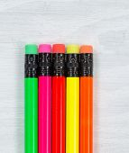foto of pencil eraser  - Close up of colorful pencil tip erasers on white desktop - JPG