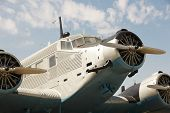 pic of propeller plane  - Old fashioned plane with three propellers - JPG