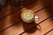 stock photo of latte  - Cup of cafe latte on the wooden table - JPG