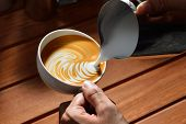 image of latte  - Making of cafe latte art on the wooden table - JPG