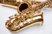 foto of musical instruments  - gold saxophone isolated over white - JPG