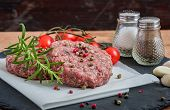 foto of hamburger  - Raw Minced Hamburger Meat with Herb and Spice Prepared for Grilling  - JPG