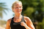 image of workout-girl  - Running woman sweating workout with earphones - JPG