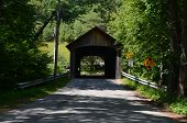 picture of covered bridge  - A wooden covered bridge on a country road - JPG