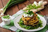 foto of dipping  - Homemade potato pancakes with fresh cheesy dip with herbs and spring onion - JPG