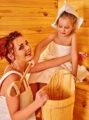stock photo of sauna  - Happy mother with daughter relaxing at sauna - JPG