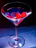 stock photo of black-cherry  - Transparent cherry cocktail on black background - JPG