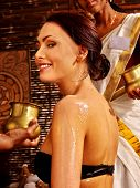 pic of ayurveda  - White young woman having oil Ayurveda spa treatment - JPG