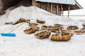 Постер, плакат: Tools Of The Salt Farmers On Salt Pans