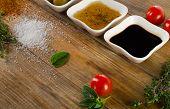 pic of vinegar  - Dressing ingredients on rustic wooden background - JPG
