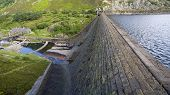 Reservoir And Dam With High Water Level Overlooking Pumping Station