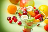 picture of fruit bowl  - Fruit salad of organic fruit in glass bowl on table - JPG
